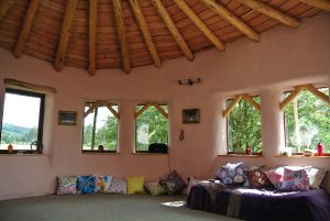 Sunny outside....warm and pink inside! Ty Mam Mawr straw bale roundhouse