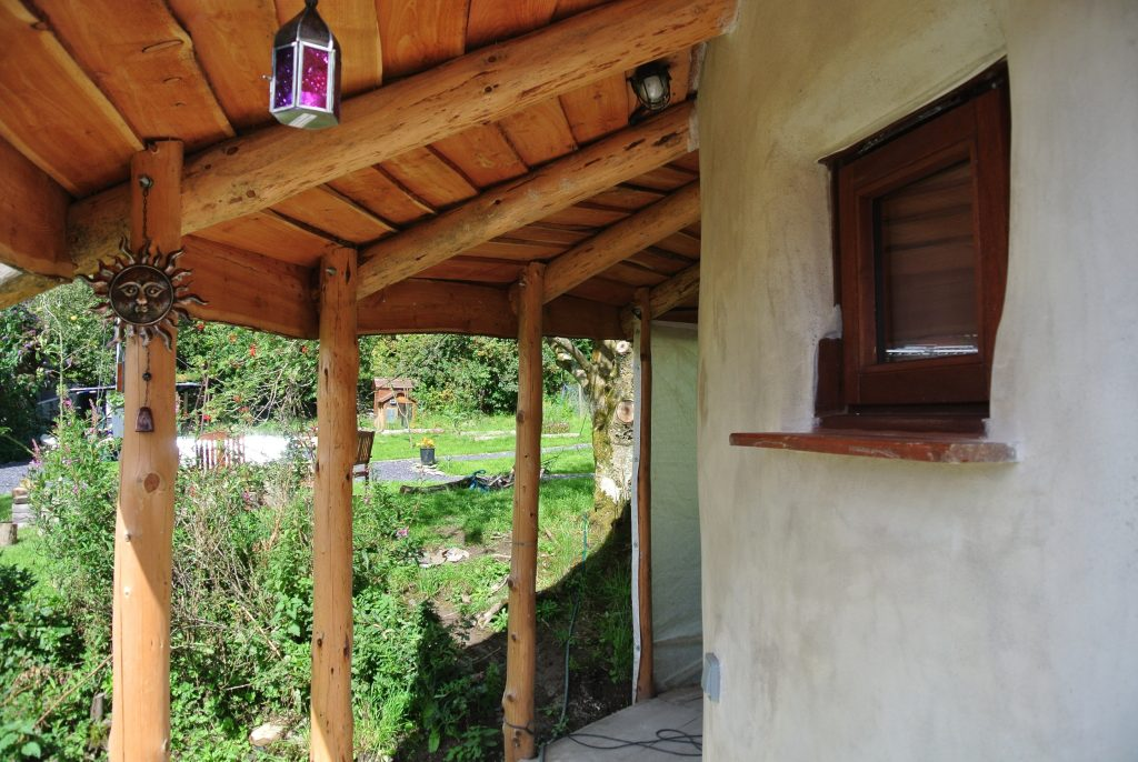 The porch on the straw bale roundhouse at ty Mam Mawr eco retreat centre - Nearly ready for painting now