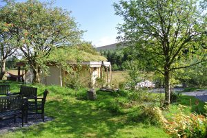 Fire pit and roundhouse at Ty Mam Mawr eco retreat centre