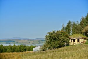 Ty Mam Mawr - Straw bale roundhouse and Yurt view to west with Arenig Fawr in sight