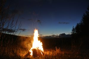 Grandfather fire under the night sky at Ty Mam Mawr eco retreat centre