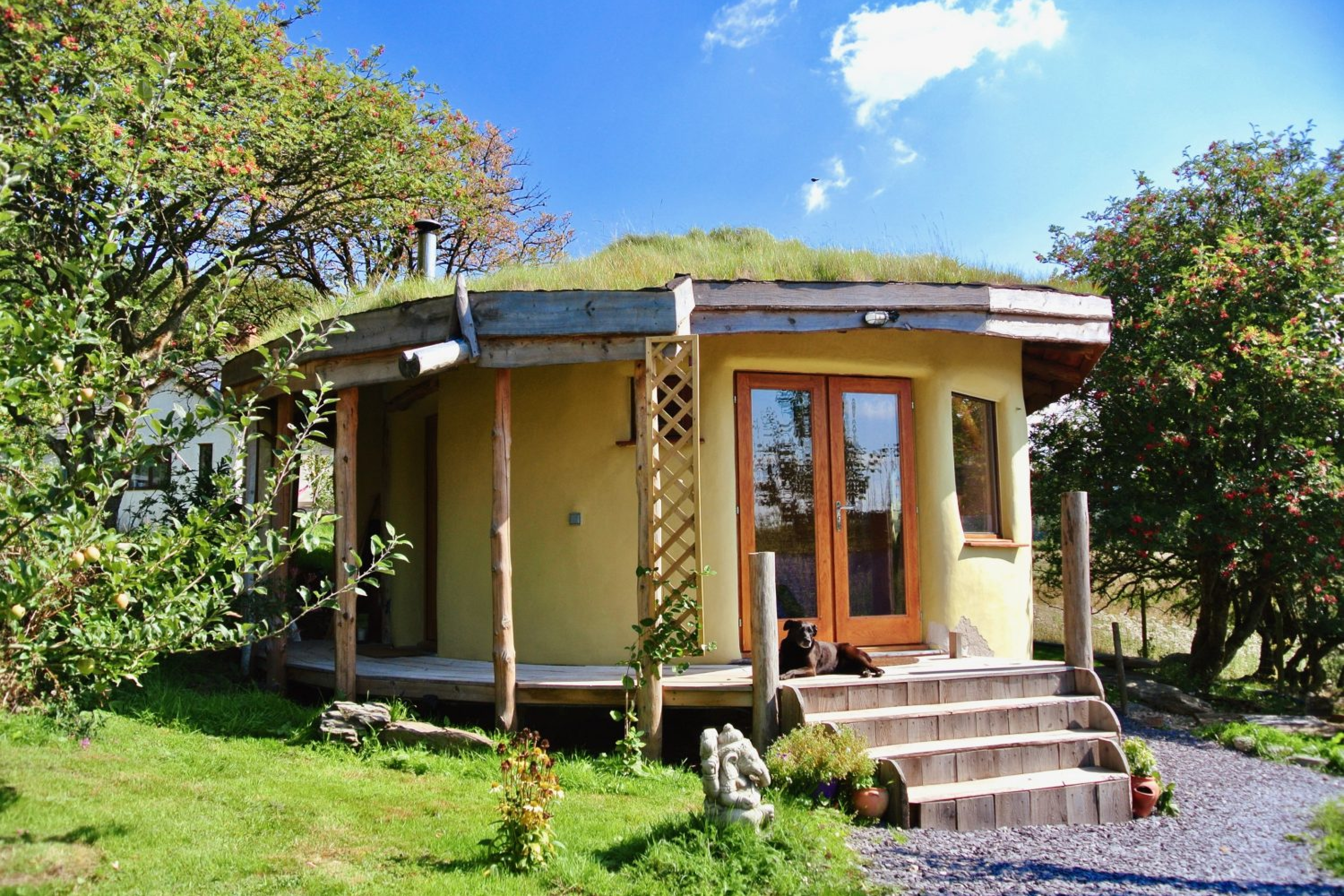 Straw bale roundhouse at intimate off grid eco retreat centre Ty Mam Mawr in North Wales