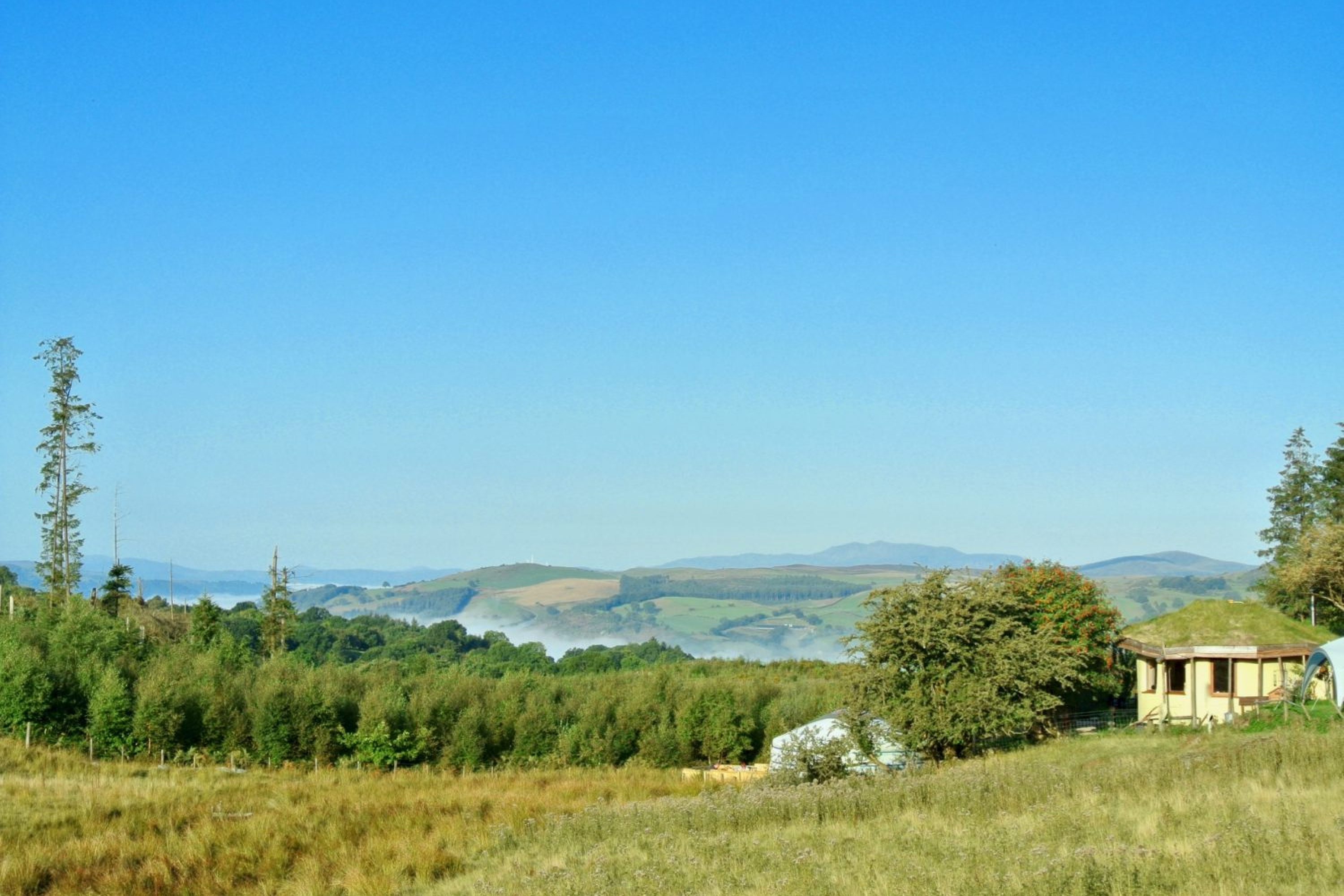 Ty Mam Mawr Off Grid Eco Retreat Centre - Roundhouse and Big Yurt view west to Snowdonia